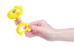 toy rattle giraffe in hand on white background isolation