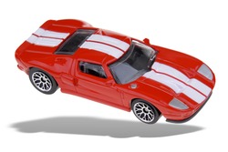 Toy red Sports car isolated over white with a clipping path