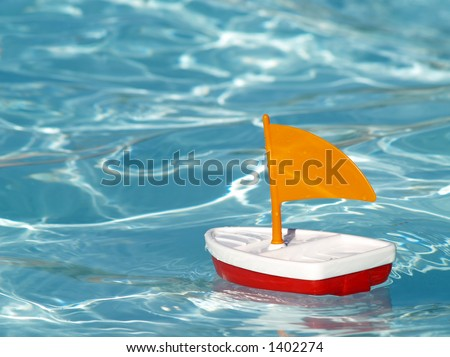 toy sailboat in a swimming pool #1402274