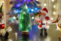 toy Santa Claus and a little Christmas tree