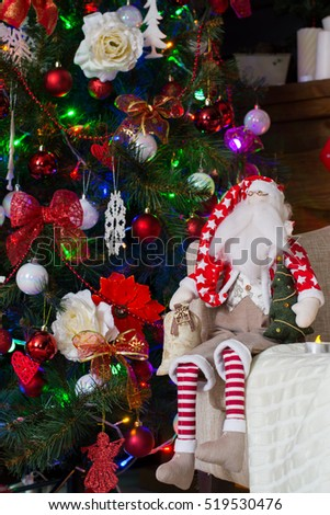 toy santa claus and christmas tree with holiday decorations - Santa Claus Christmas Tree Decorating Ideas