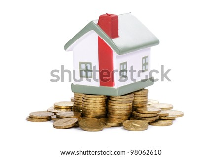 Toy small house and coins . concept