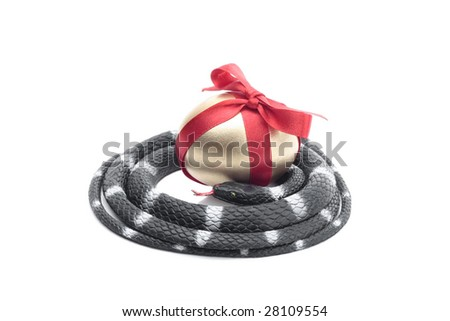 Toy Snake stealing gold egg isolated over white background