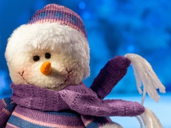 toy snowman on blue chirstmas background