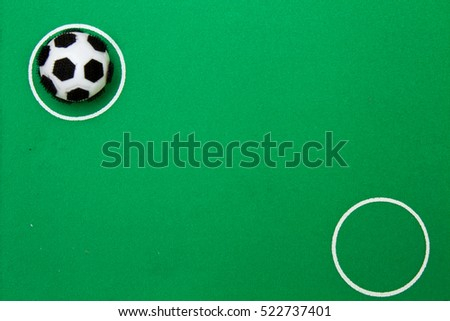 toy soccer ball on the football field, ball on green grass #522737401