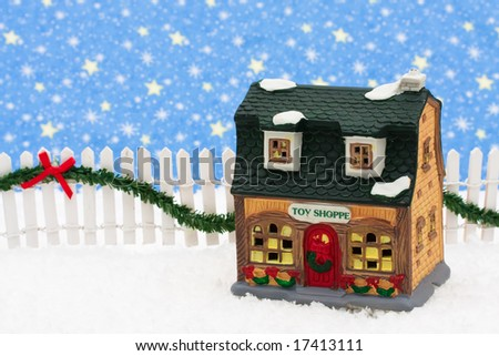 Toy store and white picket fence with green garland and red bow, merry Christmas