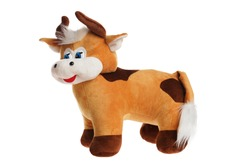 Toy stuffed cow puppet isolated at white background. Symbol of chinese new year.  Cuddly toy animal.