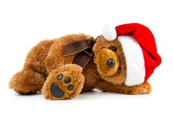 Toy teddy bear wearing a santa hat isolated on white background