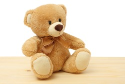 toy teddy on wood background