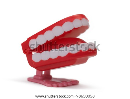 Toy teeth isolated on white background