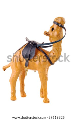 Toy the African camel, yellow colour in a brown harness