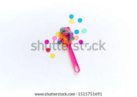 Toy tool for experiments and experiments. Science for the child. Bright rainbow. White background. Montessori's childcare system. Kindergarten school