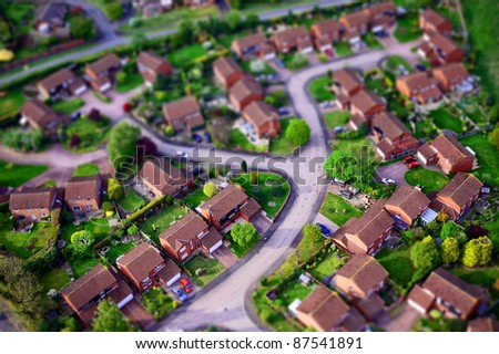 Toy town. housing estate from the air made to look like a miniature - stock photo