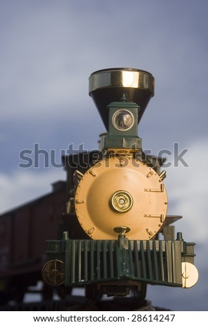 Toy train with clouds in background