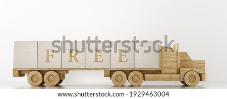 Toy truck transports large wooden cubes to advertise the service offered Stock foto ©
