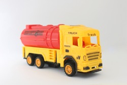 Toy truck​ yellow​ and​ red​ color​ isolated​ on​ white​ background.