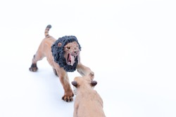 Toy two Smilodon saber-toothed roaring and in attack position fighting with white background diagonal view