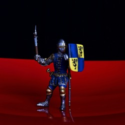 Toy warrior and knight in armour with a sword.