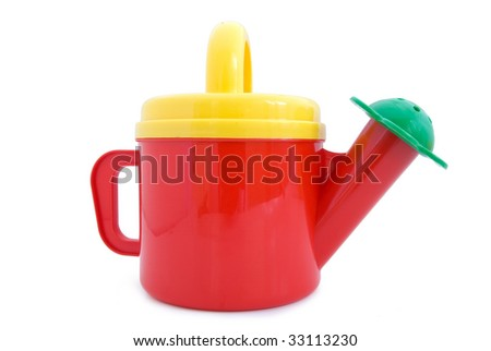 Toy watering can. Isolated on white background.