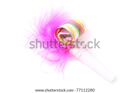 Toy whistle with pink feather over pure white background