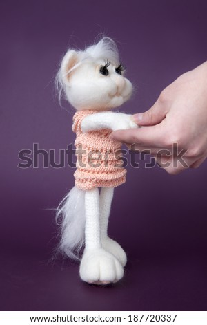 Toy white cat on purple background. Gift for holiday. Handmade Felt.