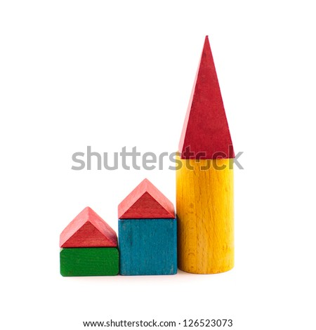 Toy wooden house  from coloured blockes isolated on white background. Building, construction concept.