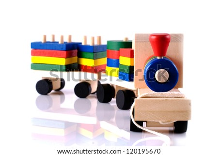 Toy wooden train with reflection on white background