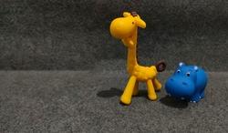 toy yellow giraffe and hippo