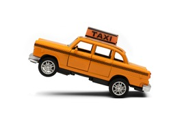 toy - yellow taxi car model. isolated on white background. yellow taxi car. idea, symbol, concept of urban service