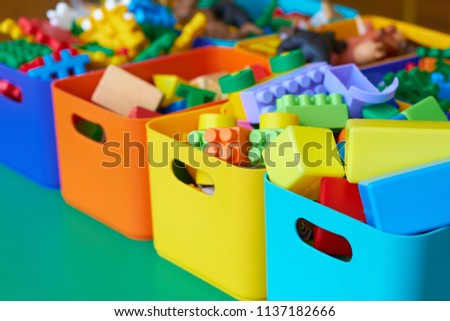 Photo of Toys and cubes for children in colorful boxes.