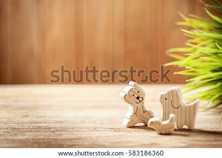toys background, cute wooden toy animal on wood board, tiny toys and shallow depth of field ストックフォト ©