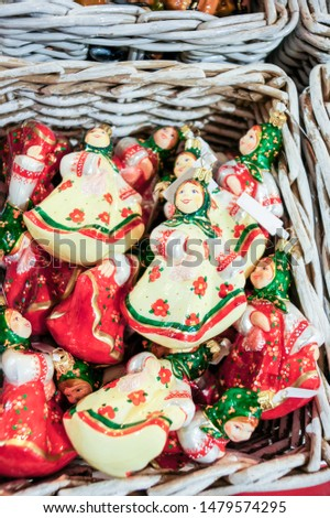 Toys in the basket. Christmas tree decorations and decorations in the design.