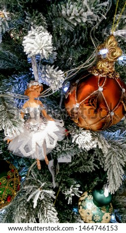 Toys in the spruce branches. Christmas tree decorations and decorations in the design.