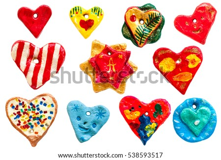 Toys made of salty dough for a Christmas tree, and on Valentine's Day. Set of hearts in different shapes and patterns #538593517