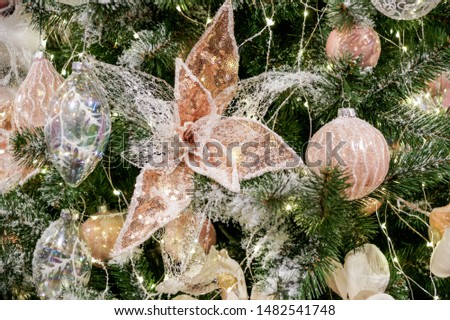 Toys on spruce branches. Christmas tree decorations and decorations in the design.
