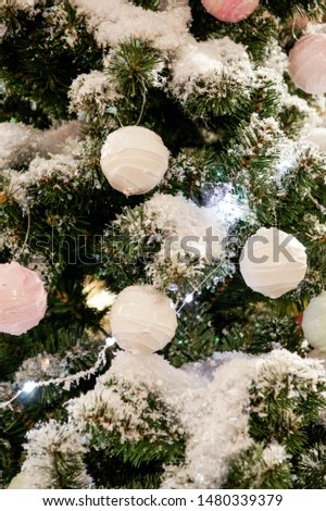 Toys on the branches. Christmas tree decorations and decorations in the design.