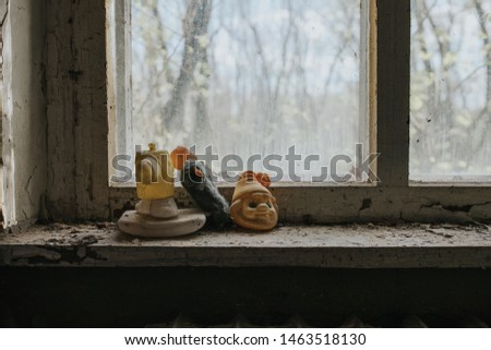 Toys on the windowsill of a kindergarten in Pripyat. Chernobyl exclusion zone.