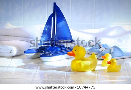 Toys with white towels on bathroom floor
