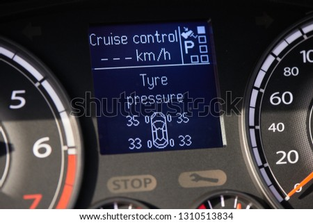 TPMS (tyre pressure monitoring system) monitoring display on a dashboard of a car #1310513834