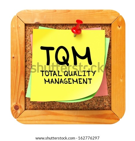 TQM -  Total Quality Management - Written on Yellow Sticker on Cork Bulletin or Message Board. Business Concept.
