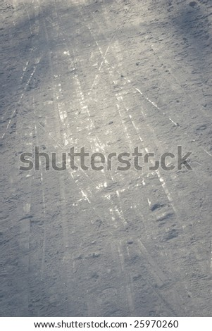 Trace from skis on snow.