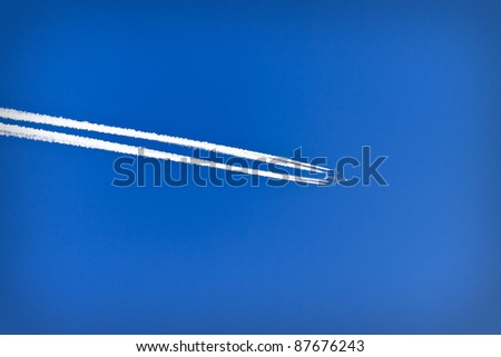 Trace of an airplane against blue sky