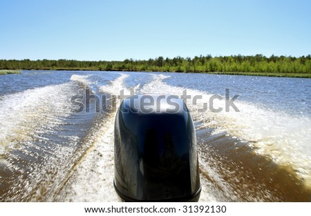 Trace on water from a boat. Siberia, the river Sogom