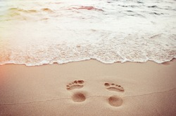 traces of feet on the sand