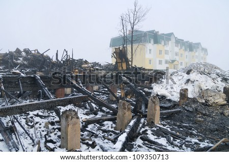 Traces of fire with a newly built house in the background