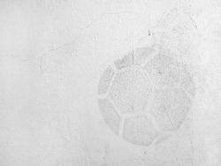 traces of soccer ball imprint on old white concrete wall, dirt stain on cement surface caused by kicking soccer ball hits stadium wall, abstract sports background, close up white copy space