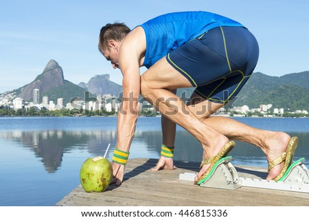 7ddfa8966c3512 Track athlete crouching at starting blocks in flip flops with coco gelado  drinking coconut in front