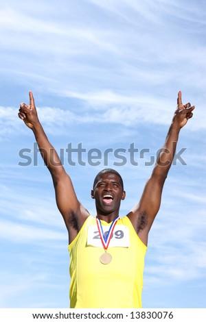 Track athlete with medal celebrating