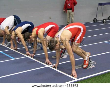 Track Athletes in Starting Blocks