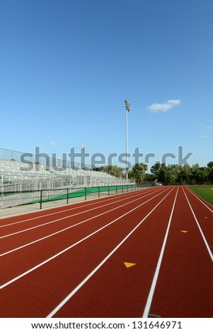 Track Field on a sunny day and blue sky on a vertical format